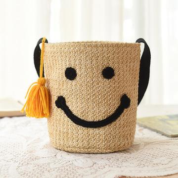 新款韩国大爱女可爱水桶包 笑脸编织挎包单肩包沙滩包度假草编包