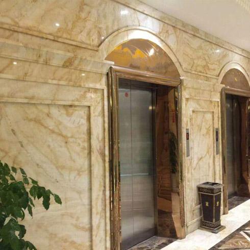翡御石业新型石材-电梯走廊效果