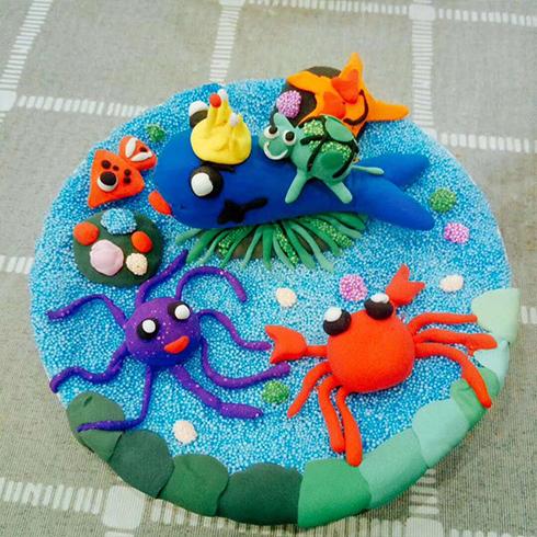 海洋世界的海滩是用珍珠泥做的,海滩上的动物都是用彩泥捏出来的,看